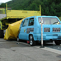 Lightweight car after impact test against a TMA on the rear of a lorry