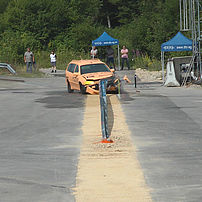 Test vehicle during impact test TB32 to a rammed safety barrier