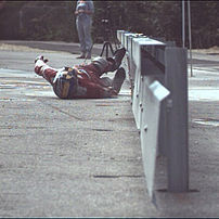 Impact test motorcyclist: HIII 50% dummy before impact to an underride protection on a rammed steel safety barrier