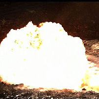 Fireball during mine explosion next to vehicle, side blast